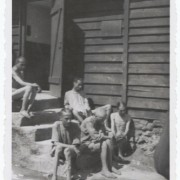 "Survivors in front of the so-called ""station"" in Gusen I, May 1945"